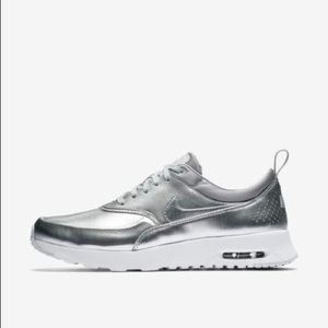 Brand new with tags Silver Nike Thea